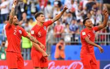 (L to R) England's defender Kyle Walker, England's defender John Stones and England's midfielder Jesse Lingard celebrate at the end of the Russia 2018 World Cup quarter-final football match between Sweden and England. Picture: AFP
