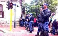 Heavily-armed police block Wale Street during protests in Cape Town on 30 October 2013. Picture: Graeme Raubenheimer/EWN