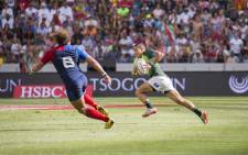 Juan de Jongh shakes off a tackle in the Blitzboks' 21-12 victory over France in the Cape Town Sevens semi-final on 13 December 2015. Picture: Aletta Harrison/EWN.
