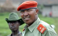 A picture taken on January 11, 2009 shows rebel General Bosco Ntaganda, self declared leader of the CNDP, escorted by comrades at his mountain base in Kabati. Picture: AFP