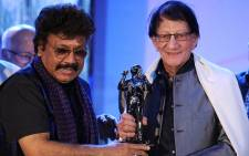 (FILES) In this file photo taken on February 29, 2016 Bollywood music director/composer Shravan Rathod (L) and writer/lyricist Yogesh Gaur pose for a photograph during the Ravindra Jain Academy Awards ceremony in Mumbai. Picture: AFP.