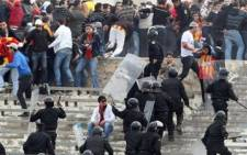 Tunisian security forces clash with Esperance fans on January 9, 2011 during a Tunisian championship match against Etoile du Sahel in Sousse. Picture: AFP.