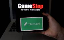 This photo illustration shows the logos of video grame retail store GameStop and trading application Robinhood on a computer and on a mobile phone in Arlington, Virginia on January 28, 2021. An epic battle unfolded on Wall Street, with a cast of characters clashing over the fate of GameStop, a struggling chain of video game retail stores. The conflict  sent GameStop on a stomach-churning ride with amateur investors taking on the financial establishment in the mindset of the Occupy Wall Street movement launched a decade ago. Olivier Douliery / AFP