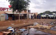 Police Nyalas outside a shop that was looted in Bekkersdal. 25 October 2013. Picture: Govan Whittles/EWN
