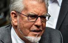 FILE: Veteran entertainer Rolf Harris arrives at Southwark Crown Court in central London on 4 July 2014. Picture: AFP.