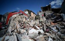 FILE: Rescuers and firemen inspect the rubble of buildings in Amatrice on August 24, 2016 after a powerful earthquake rocked central Italy. Picture: AFP.