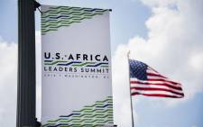 A sign advertising the upcoming US-Africa Leaders' Summit hangs from a light pole outside the US State Department in Washington, DC, 31 July, 2014. Picture: AFP.