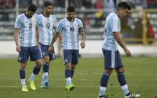 Argentina's Mateo Mussacchio, Matias Caruzzo (2nd-L) and Ever Banega leave the field after losing their 2018 FIFA World Cup qualifier football match against Bolivia in La Paz, on 28 March, 2017. Picture: AFP.