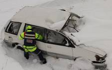 A paramedic tries to rescue a person trapped in the snow in Kokstad. Picture: Netcare