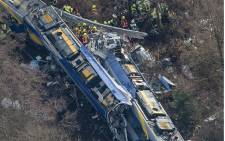 Aerial view shows firefighters and emergency doctors working at the site of a train accident near Bad Aibling, southern Germany, on February 9, 2016. Two Meridian commuter trains operated by Transdev collided head-on near Bad Aibling, around 60km southeast of Munich. Picture: AFP