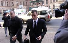 Oscar Pistorius gets dropped of in front of the High Court in Pretoria ahead of Day 37 of his murder trial on 3 July 2014. Picture: Reinart Toerien/EWN