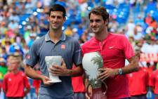 Roger Federer of Switzerland (R) and Novak Djokovic of Serbia pose with the trophies after Federer won in two sets to win the mens singles final at the Western & Southern Open at the Linder Family Tennis Center on 23 August, 2015 in Cincinnati, Ohio. Picture: AFP.