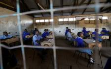 Pupils sit inside their classroom ahead of the primary school final national examinations at Kiboro Primary school along Juja road in Nairobi, Kenya, on 31 October 2017. Picture: Reuters