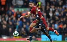 Liverpool's Croatian defender Dejan Lovren (top) vies with Manchester City's English midfielder Raheem Sterling during the English Premier League football match between Liverpool and Manchester City at Anfield in Liverpool, north-west England on 7 October 2018. Picture: AFP