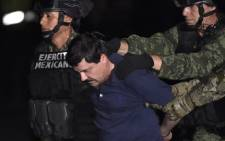 "FILE: Drug kingpin Joaquin ""El Chapo"" Guzman is escorted into a helicopter at Mexico City's airport on 8 January, 2016 following his recapture during an intense military operation in Los Mochis, in Sinaloa State. Picture: AFP."