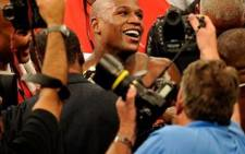 FILE: Floyd Mayweather Jr. reacts after defeating Shane Mosley by unanimous decision after the welterweight fight at the MGM Grand Garden Arena. Picture: AFP.