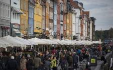 FILE: Visitors crowd the waterfront cafes by the Nyhavn canal in Copenhagen. The 17th-century waterfront, canal and entertainment district is popular with tourists visiting the Danish capital. Picture: AFP