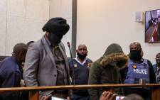 Police officers Simon 'Scorpion' Ndyalvana and Caylene Whiteboy appear in the Protea Magistrates Court on 31 August 2020 in connection with the shooting death of 16-year-old Nathaniel Julies in Eldorado Park. Picture: Kayleen Morgan/EWN
