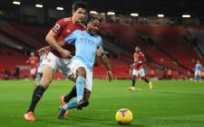 Manchester City midfielder Raheem Sterling vies with Manchester United defender Harry Maguire (L) during the English Premier League football match between Manchester United and Manchester City at Old Trafford in Manchester, north west England, on 12 December 2020. Picture: AFP