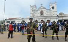 Sri Lankan security personnel keep watch outside the church premises following a blast at the St. Anthony's Shrine in Kochchikade, Colombo on 21 April 2019. Explosions have hit three churches and three hotels in and around the Sri Lankan capital of Colombo, police said on 21 April. Picture: AFP