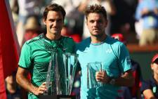 Roger Federer of Switzerland poses for photographs after his straight sets victory against Stanislas Wawrinka of Switzerland in the mens final during day fourteen of the BNP Paribas Open at Indian Wells Tennis Garden on 19 March, 2017 in Indian Wells, California. Picture: AFP.