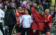 Chelseas Portuguese manager Jose Mourinho watches as Chelseas Czech goalkeeper Petr Cech leaves the field after injury during the UEFA Champions League first leg semi-final football match Club Atletico de Madrid vs Chelsea at the Vicente Calderon stadium in Madrid on 22 April, 2014. Picture: AFP.