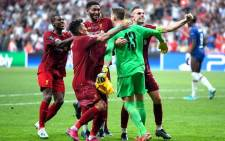 Liverpool players mob goalkeeper Adrian after he saved a penalty to give the side victory in the UEFA Super Cup match in Istanbul on 14 August 2019. Picture: @LFC/Twitter