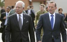 FILE: Australian Prime Minister Tony Abboott (right) says searchers are confident they know the estimated position of the black boxes. Picture: AFP.