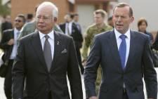 FILE: Malaysia Prime Minister Najib Razak walks with Australia's Prime Minister Tony Abbott. Picture: AFP.