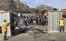 Protesting Hout Bay residents say they're tired of delays in the building. Picture: Monique Mortlock/EWN.