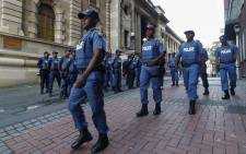Police officers are seen on the grounds of Parliament in Cape Town. Picture: @SAgovnews/Twitter.