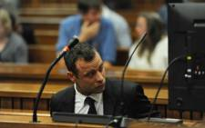 FILE: Oscar Pistorius in the dock after arriving at the High Court in Pretoria on the fourth day of his murder trial Thursday on 6 March 2014. Picture: Pool.