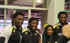 Fans seize the opportunity to get a picture snapped with Springboks Lwazi Mvovo, Scarra Notbeni and Siya Kolisi. Picture: Phumlani Pikoli/EWN