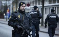 A police officer guards the street around the Noerrebro train station in Copenhagen on 15 February, 2015 where a man has been shot in a police action following two fatal attacks in the Danish capital. Picture: AFP.