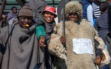 Movement for Economic Change (MEC) party leader Selibe Mochoboroane (L) takes part in a protest against regulations forcing farmers to sell their wool and mohair to a Chinese broker, outside the Parliament building in Maseru, Lesotho, on 28 June 2019. Picture: AFP