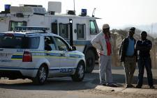 A heavy police presence was in place in the area surrounding the Lonmin Marikana Mine after violent protests. Picture: Taurai Maduna/EWN