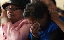Bridget Langley, mother of murdered Uitsig teenager Justin Langley, weeps during a joint memorial service for her son and her brother Barend on 16 November 2014. Picture: Aletta Gardner/EWN
