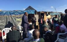 Premier David Makhura addresses a church service in Plastic View informal settlement after a deadly shack fire. Picture: Dineo Bendile/EWN.