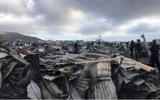 Masiphumelele residents survey the damage a day after a fire swept through the settlement on 29 July 2019. Picture: Monique Mortlock/EWN