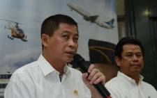Indonesias Transport Minister Ignasius Jonan (L) speaks while Director General for Air Transportation Suprasetyo (R) listens during a press conference in Jakarta on August 16, 201, announcing that a missing plane carrying 54 people has crashed into a mountain in the eastern Indonesian province of Papua. Picture: AFP.