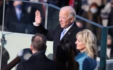 Joe Biden is sworn in as US President as his wife Jill Biden looks on during his inauguration on the West Front of the US Capitol on 20 January 2021 in Washington, DC. Picture: Tasos Katopodis/POOL/AFP
