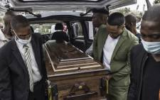 The coffin containing the remains of Njabulo Allen Dlamini (31) a father of 11, arrives on 21 July 2021 for a funeral service at his home. The taxi driver was killed in Phoenix, Durban, on 12 July, allegedly by a group of South African Indian residents manning a roadblock while defending their properties from looters. Picture: MARCO LONGARI/AFP