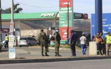 eSwatini soldiers and police officers are seen on the streets near the Oshoek Border Post between eSwatini and South Africa on 1 July 2021. Picture: AFP