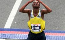 South African Lusapho April reacts after he crosses the finish line during the New York City Marathon on November 3, 2013. Picture: AFP