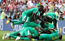 Senegal team members celebrate after their victory over Poland on 19 June 2018 during the Fifa World Cup. Picture: @FIFAWorldCup/Twitter