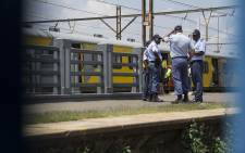 FILE: Officials and rescue services personnel on the scene of a train crash in Germiston on 9 January, 2018. Picture: Ihsaan Haffejee/EWN