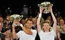 Britain's Jonathan Marray (R) and Denmark's Frederik Nielsen (L) celebrate their men's doubles final victory on day 12 of the 2012 Wimbledon Championships tennis tournament. Picture: AFP