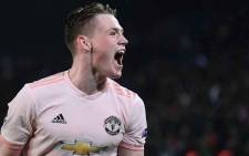 Manchester United's English midfielder Scott McTominay jubilates after winning the UEFA Champions League round of 16 second-leg football match between Paris Saint-Germain (PSG) and Manchester United at the Parc des Princes stadium in Paris on 6 March 2019. Picture: AFP