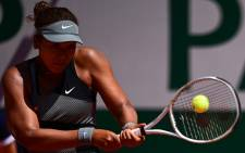 Japan's Naomi Osaka returns the ball to Romania's Patricia Maria Tig during their women's singles first round tennis match on Day 1 of The Roland Garros 2021 French Open tennis tournament in Paris on May 30, 2021. Picture: Martin Bureau / AFP.