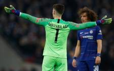 Chelsea goalkeeper Kepa Arrizabalaga gestures toward the bench after his number came up for substitution and didn't leave the pitch during the English League Cup final football match between Manchester City and Chelsea at Wembley stadium in north London on 24 February 2019. Picture: AFP